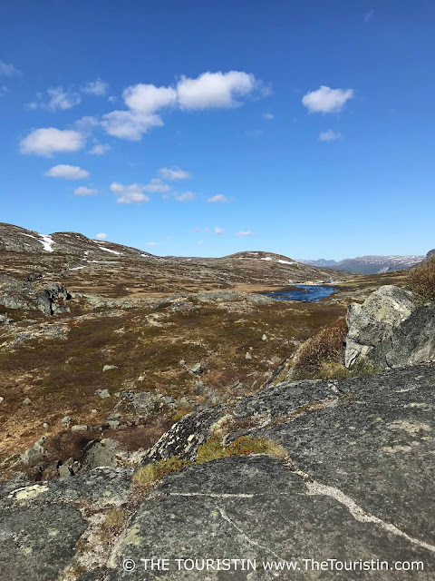 Cliffs and a blue lake on Hardangervidda Mountain Plateau in Norway.