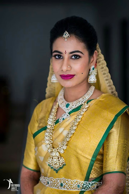 Bride in Diamond Mango Mala with Jhumkas