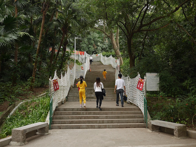 People walking up stairs lined with rope netting at Zhongshan Park in Zhongshan