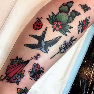 red ladybug and bird tattoo