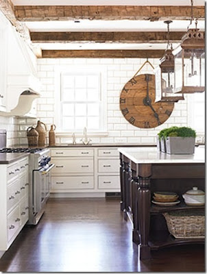 white kitchen with floor to ceiling tiles on the walls via belle vivir