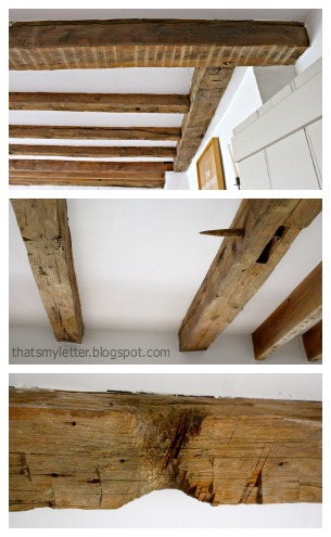 primitive farmhouse dining room exposed wood beams