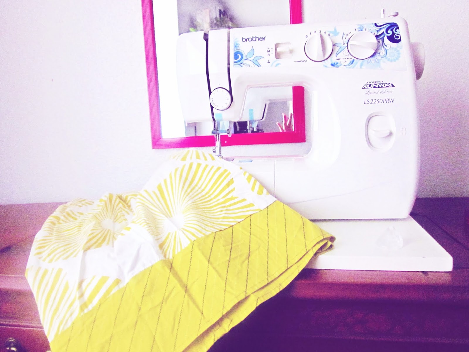 hot pink Brother Sewing Machine with yellow fabric and threads