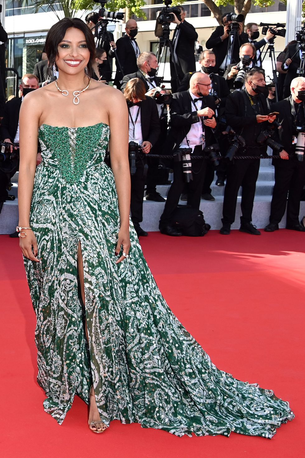 Kat Graham Kat Graham paired her emerald green gown with pomellato jewelry.