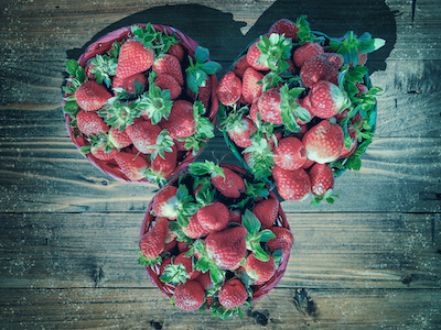 Strawberries in 3 baskets top view stock image