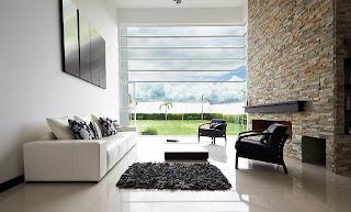 cleanly cream ceramic floor plus black and white sofas plus stoned fireplace design
