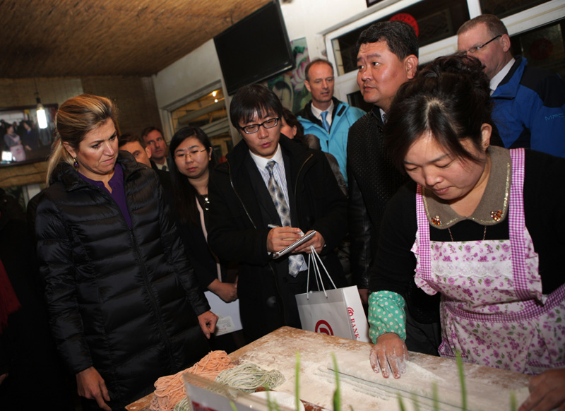Beijing hotel in Daxing district staff demonstrating the art of handmade noodle making as well as business