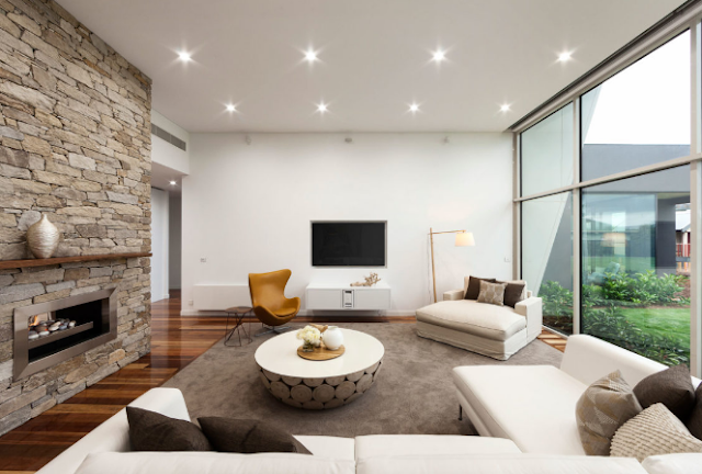 The warm living room is connected to the outside view