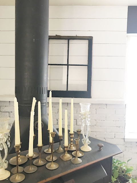 brass candlesticks on fireplace