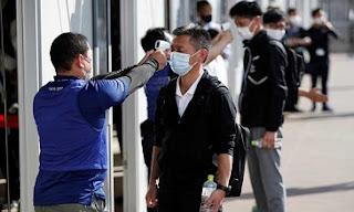 اليابان، فيروس كورونا، الكمامة، رويترز، حربوشة نيوز