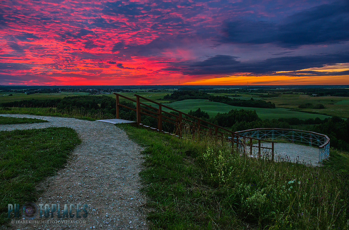 amazing view from Šatrija hill over Lithuania countryside in summer sunset time with colorful sky