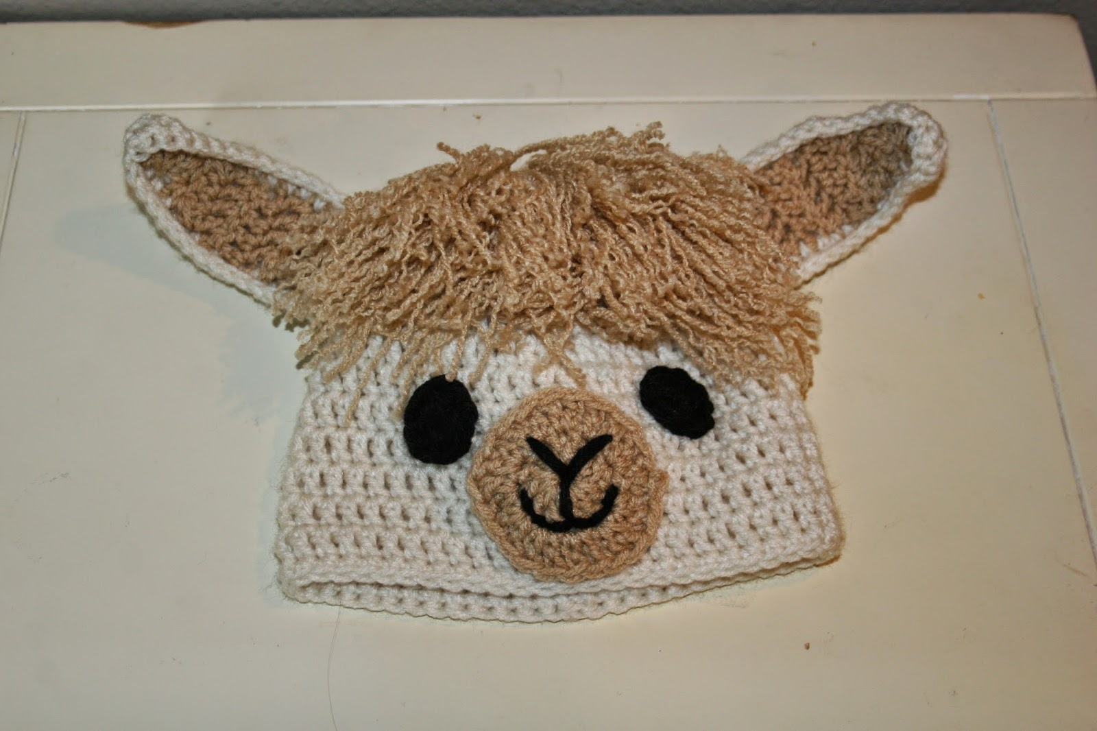 I was given the task of making her daughter a llama hat for her costume. I  couldn t find any free llama hat patterns so I created my own. b95ee2563eb