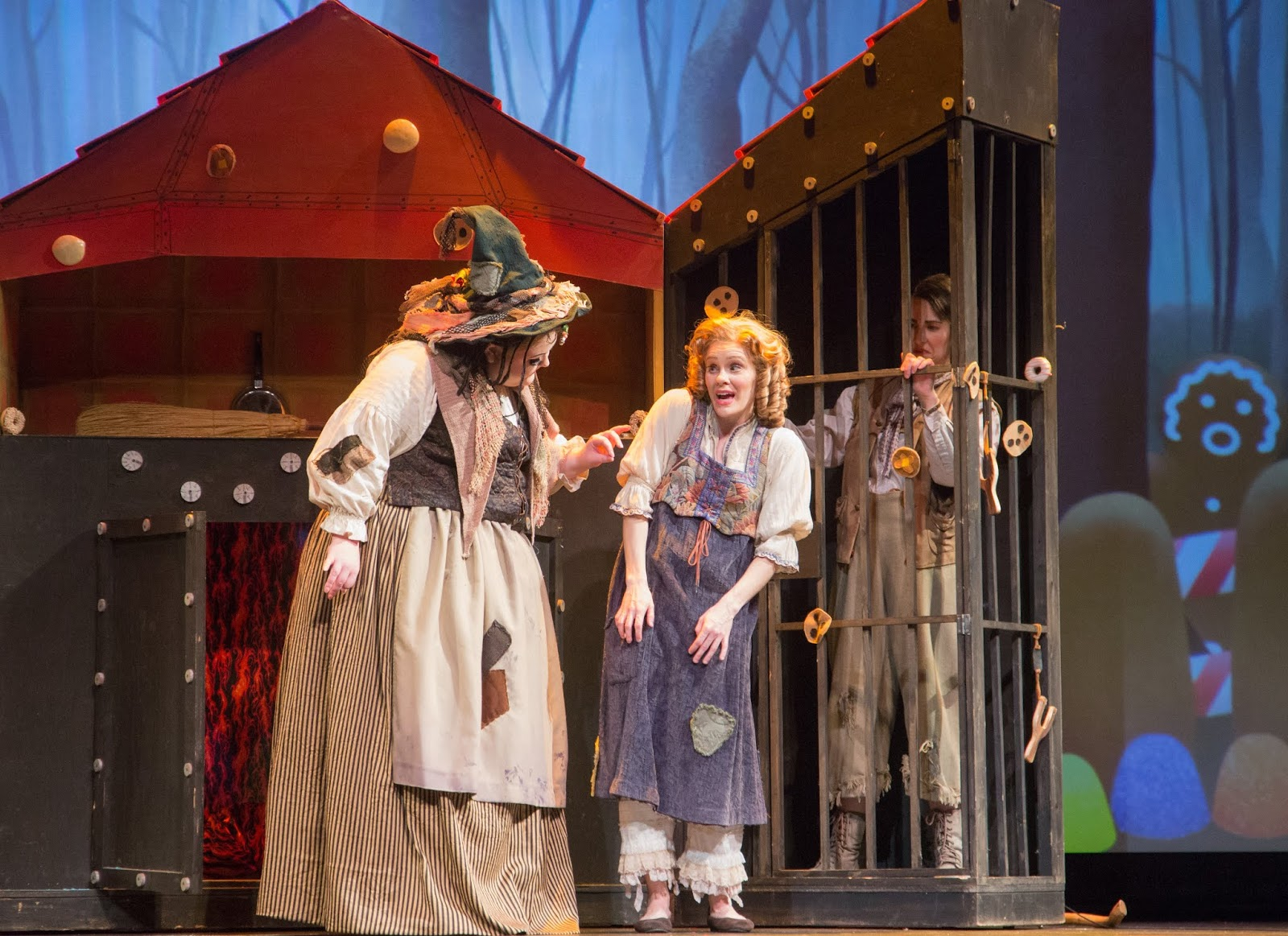 IN PERFORMANCE: (from left to right) mezzo-soprano GRETCHEN KRUPP as Die Knusperhexe, soprano JOANN MARTINSON DAVIS as Gretel, and mezzo-soprano STEPHANIE FOLEY DAVIS as Hänsel in Greensboro Opera's March 2019 of Engelbert Humperdinck's HÄNSEL UND GRETEL [Photograph © by VanderVeen Photographers]