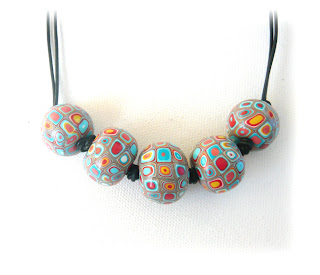 Klimet Spotted Oblate Thong Necklace handmade from polymer clay