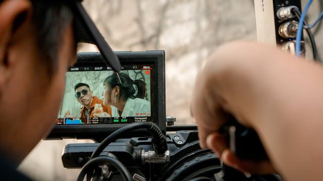 A videographer shooting a couple's video.