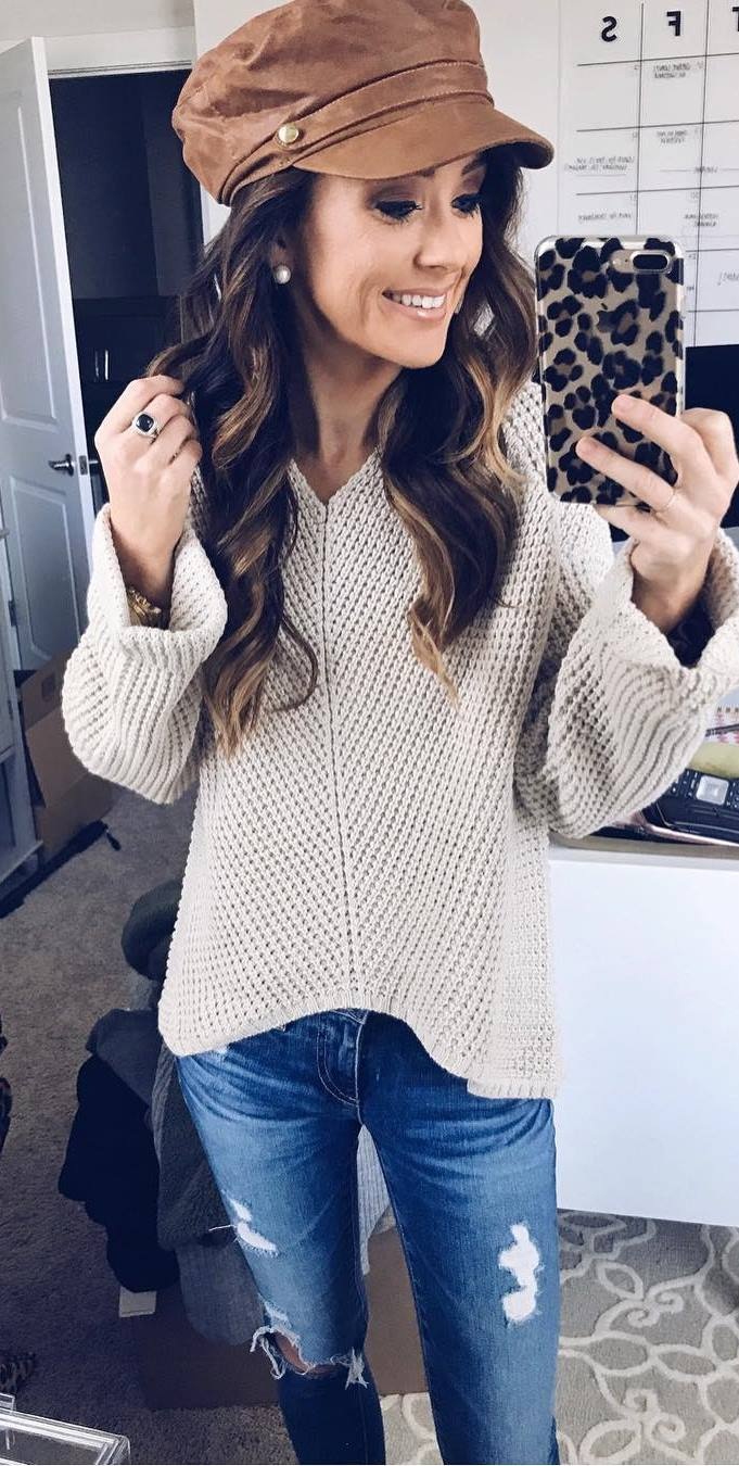 what to wear with a hat : nude knit sweater + ripped jeans
