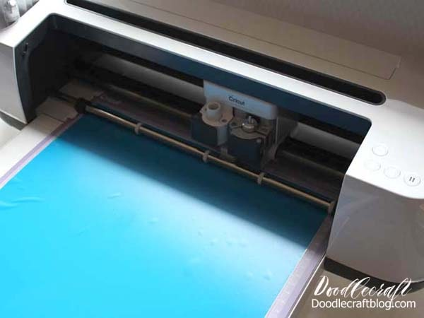 Cut blue vinyl with Cricut Maker to make a Summer Rules Cricut Vinyl Wood Sign DIY