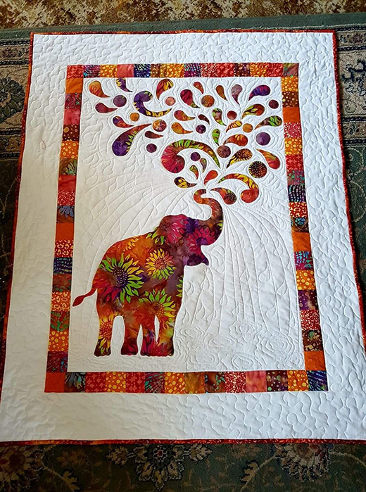 Paisley Splash Quilt designed by Myiesha & Katie, Written by Laura Jaquinto for Windham Fabrics