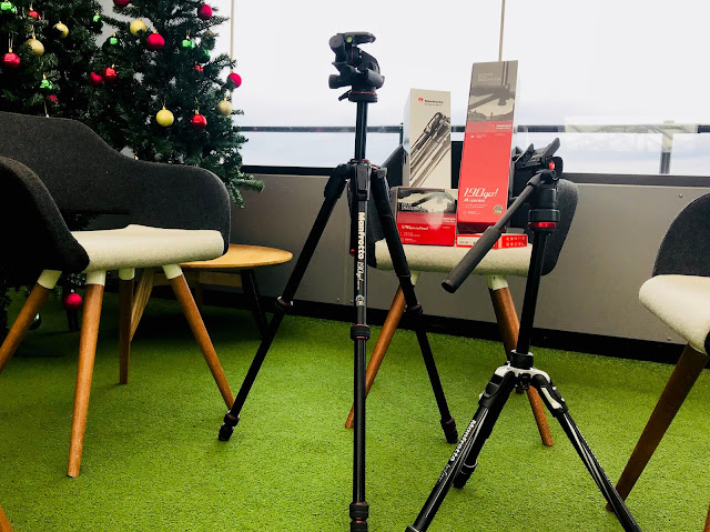 A set up with new manfrotto tripod in front of chairs
