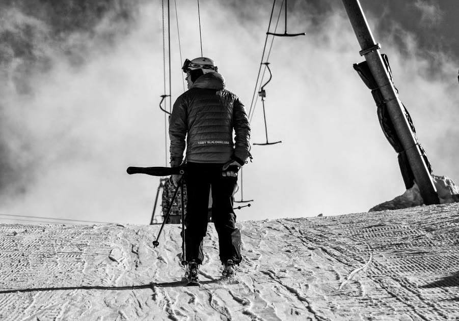 Black and white skier and lift