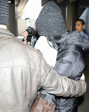 Paparazzi: Katy Perry hides in airport after being booed at Milan fashion show