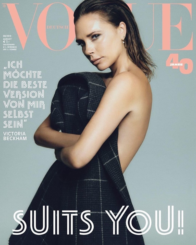Topless Victoria Beckham, 45, covers herself with a coat on cover of Vogue Germany