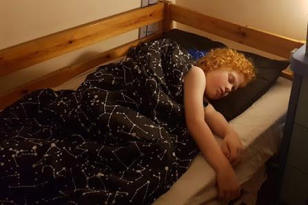 ISA NASA bedding from Dreamtex review sleeping child
