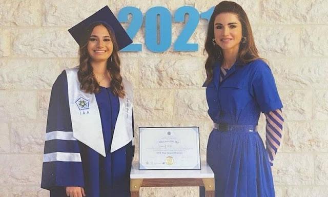 Queen Rania wore a cotton midi shirt dress and striped top by Dries Van Noten. The International Academy Amman