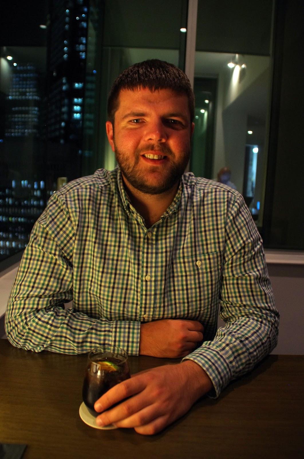dan having a drink in swissotel Sydney executive lounge