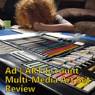 ARTdiscount 69 Piece Multi-Media Art Set and young boy concentrating colouring at the table