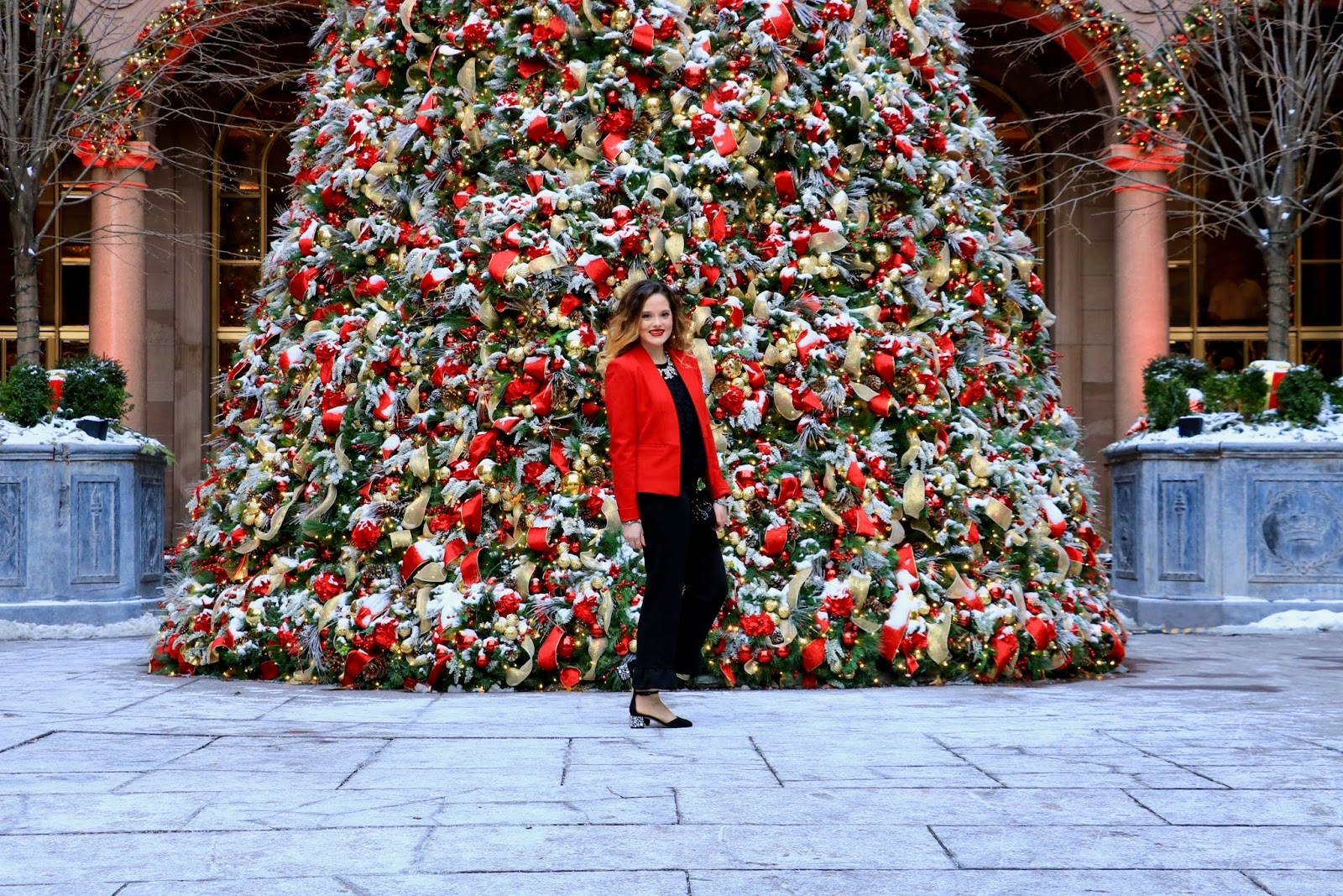 Nyc fashion blogger Kathleen Harper in front of the Lotte Palace Christmas tree