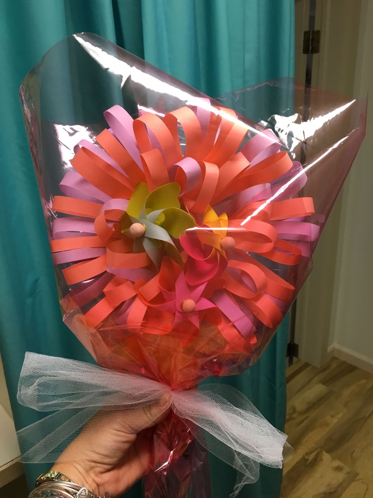 Make my day camp paper flower with pinwheels center to finish it i did glittery paper before adding the pinwheels to finish i wrapped it in cellophane so itd look more like a flower bouquet mightylinksfo