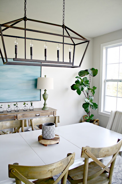 long white table with wood chairs