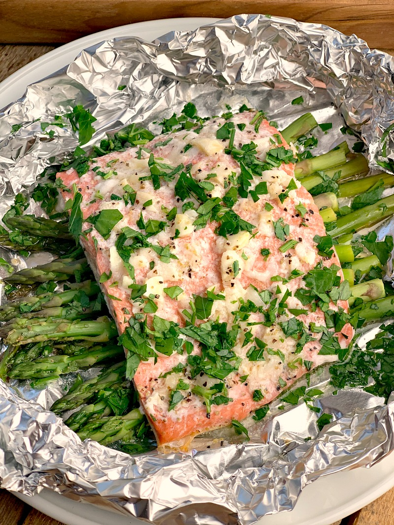 Lemon Garlic Salmon Foil Packs - Conquer your fear of grilling fish with this easy to make recipe for Lemon Garlic Salmon in foil. Delicious and easy to make with very little cleanup, it makes your summer grilling a breeze and will have the family begging for more! #keto #lowcarb #glutenfree #grilling #grilled #salmon #fish #seafood #lemon #garlic #easy #recipe   bobbiskozykitchen.com