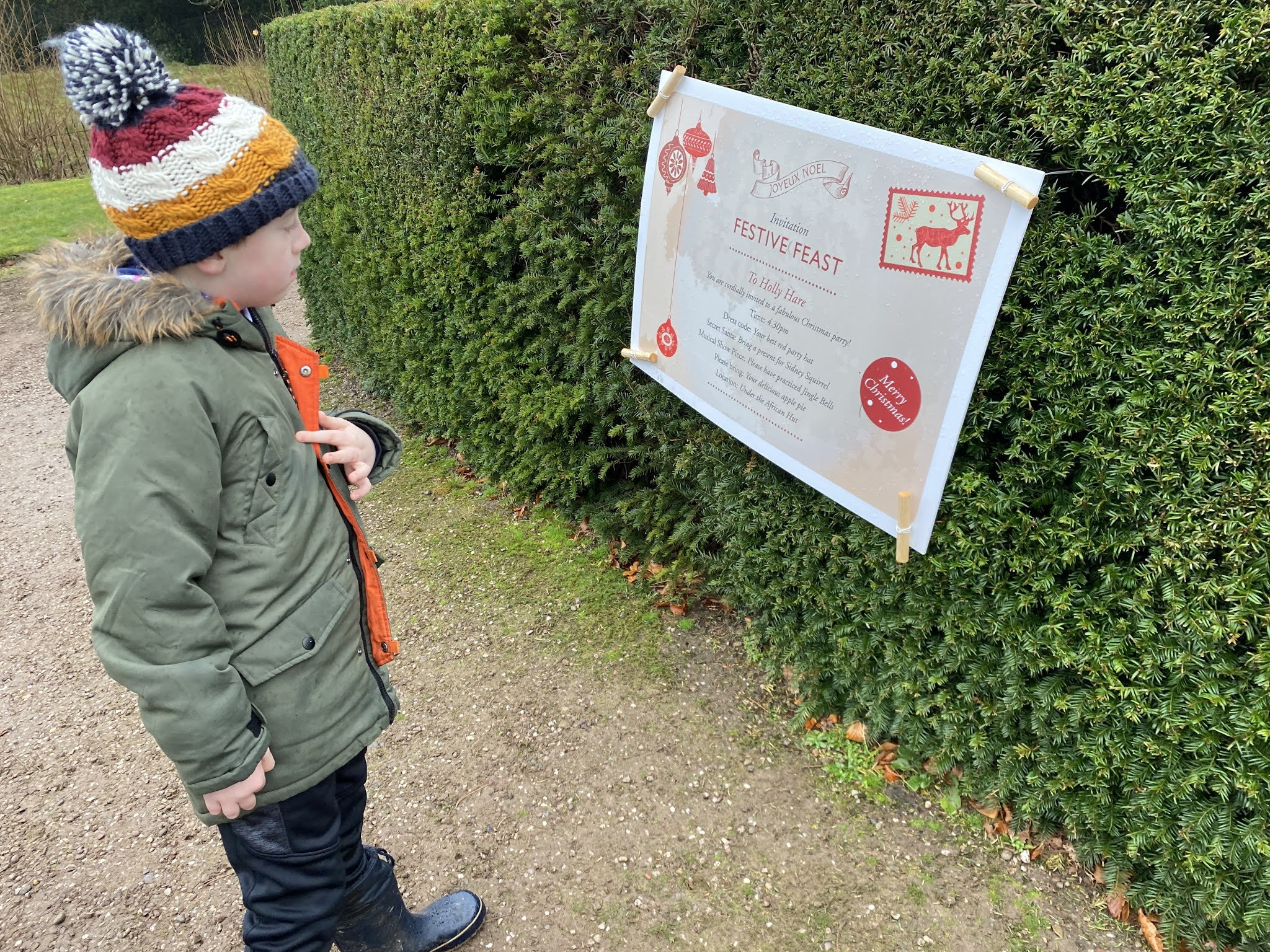 Boy looking at a sign