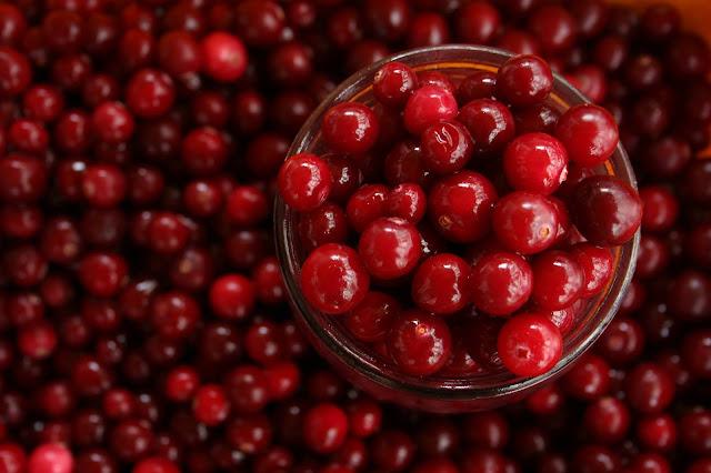 a jar full of cranberries