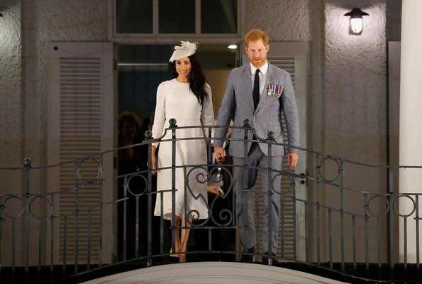 Meghan Markle wore ZIMMERMANN long sleeve dress and Duchess wore Safiyaa London Ginkgo Cape Dress
