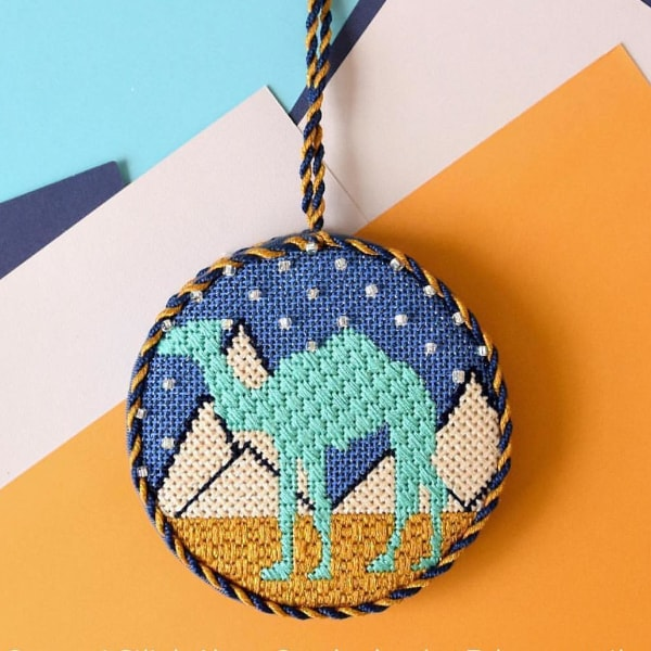 Blue camel with pyramids circular needlepoint ornament
