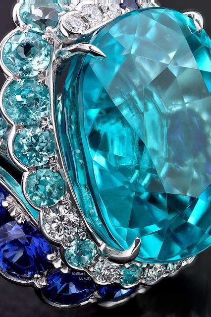 ♦David Morris 20.13ct Paraiba tourmaline Maelstrom ring with white diamonds and sapphires #jewelry #brilliantluxury