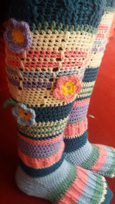 Colourful stripy crocheted socks with crocheted flowers