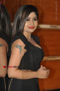 Telugu Actress Model Madhulagna Das Latest Spicy Stills in Black Short Dress  0018.JPG