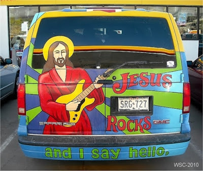 Photo of Religious van, painted with stylized Jesus playing an electric guitar. 'Jesus Rocks and I say hello.' A Post Rapture Post. How to avoid driving hazards during the end of days. marchmatron.com