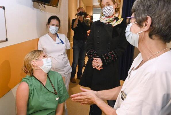 Princess Delphine of Belgium visited the Saint-Pierre Hospital, which was organizing its Vaccine Day event. Embroidered sleeve wool coat
