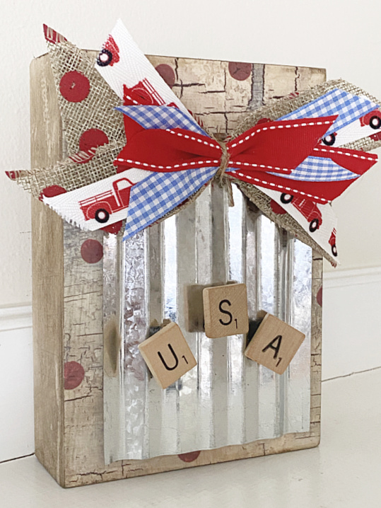 box with magnetic galvanized steel, a bow and USA Scrabble letters