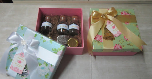 VINTAGE FLORAL BOXS WITH GREEN TEA BOTTLES.