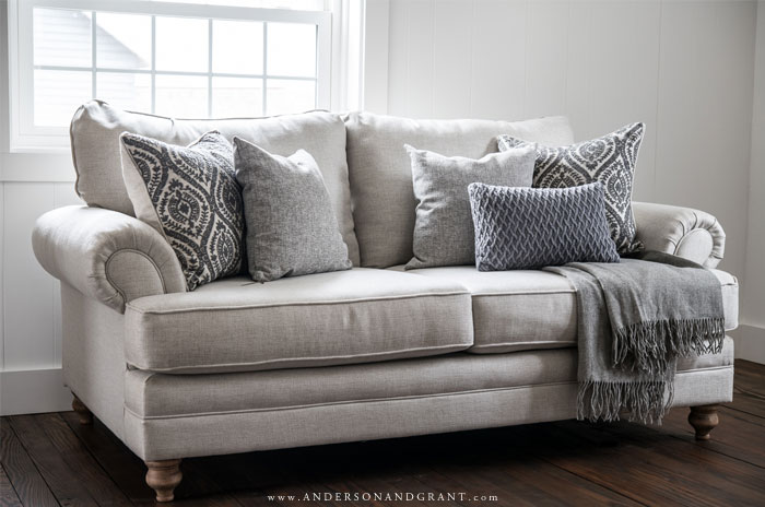 Catalina Loveseat with throw pillows and throw