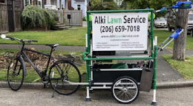 Alki Lawn Service's original company vehicle was a bicycle with a trailer