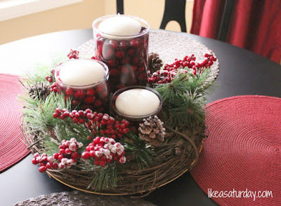 Christmas Table Centerpiece with candles, berries, and evergreen