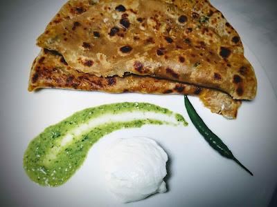 Serving Gobi paratha with curd , chutney, chilli and onion for Gobi paratha recipe