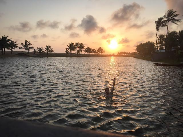 Evening swim in the lagoon; Dzita, Ghana